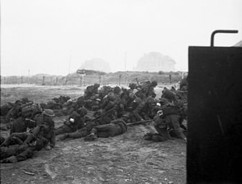 Dead and wounded infantry on Sword beach, on t...