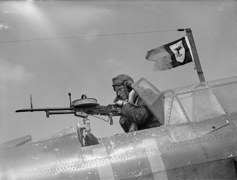 A sergeant air-gunner mans his Vickers 'K' gun...