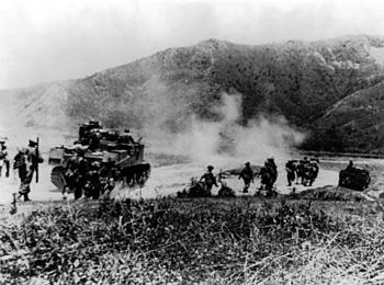 Gurkhas advancing with tanks to clear the Japa...