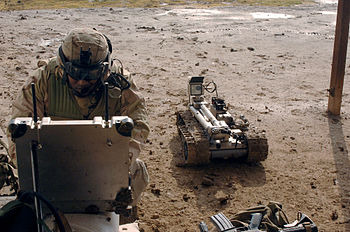 Military robot being prepared to inspect a bomb
