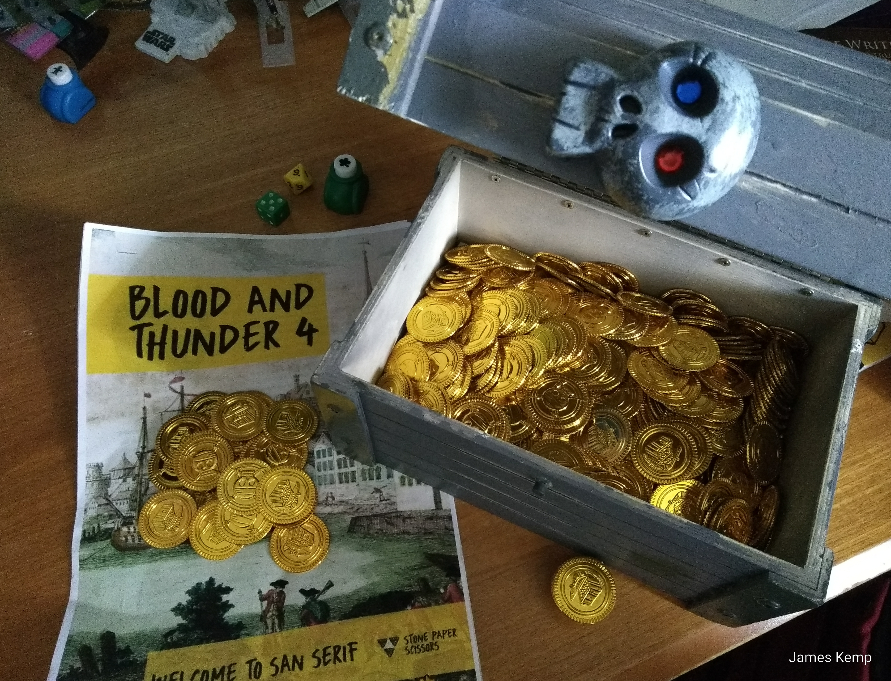 Briefing for Blood and Thunder 4 megagame and a wooden treasure chest filled with gold coins